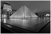 IM Pei Pyramid and reflection ponds at night, The Louvre. Paris, France ( black and white)
