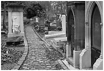 Monumental tombs in Pere Lachaise cemetery. Paris, France (black and white)