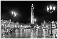 Place Vendome glistening at night. Paris, France ( black and white)