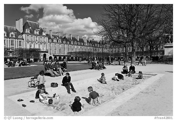 Children playing in sandbox, Place des Vosges. Paris, France (black and white)