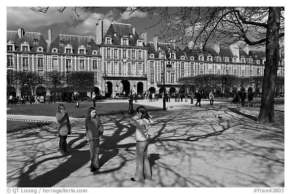 Girls playing in park, Place des Vosges. Paris, France (black and white)