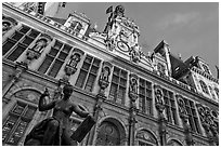 Statue Science by Jules Blanchard and Hotel de Ville at sunset. Paris, France (black and white)