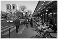 Cafe, street, and Notre Dame at dusk. Quartier Latin, Paris, France (black and white)