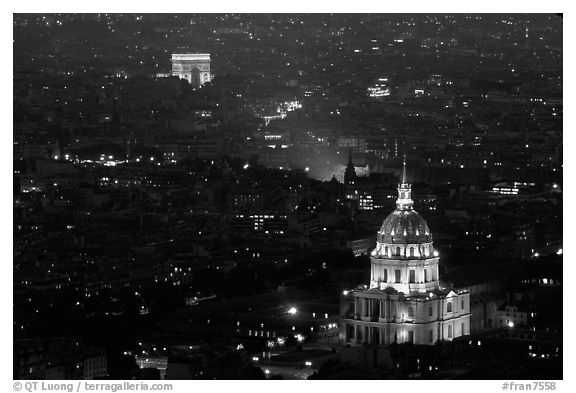 Aerial view of Arc de Triomphe and Invalides by night. Paris, France (black and white)