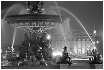 Fountain on Place de la Concorde and Assemblee Nationale by night. Paris, France (black and white)
