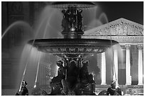 Fountain on Place de la Concorde and Madeleine church at night. Paris, France (black and white)