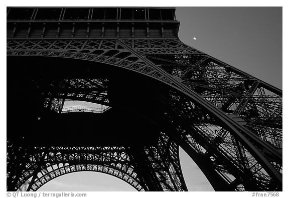 Base of Tour Eiffel (Eiffel Tower) with moon. Paris, France (black and white)