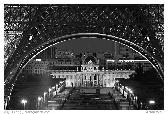 Ecole Militaire (Military Academy) seen through Eiffel Tower at night. Paris, France (black and white)
