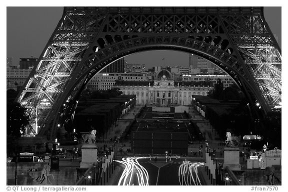 Ecole Militaire (Military Academy) seen through Tour Eiffel  at dusk. Paris, France (black and white)