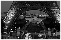 Ecole Militaire (Military Academy) seen through Tour Eiffel  at dusk. Paris, France ( black and white)