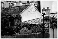 Au Lapin Agile, a famous historic cabaret, Montmartre. Paris, France ( black and white)
