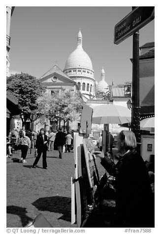 Painter on Place du Tertre, with the Sacre Coeur in the background, Montmartre. Paris, France (black and white)