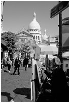 Painter on Place du Tertre, with the Sacre Coeur in the background, Montmartre. Paris, France ( black and white)