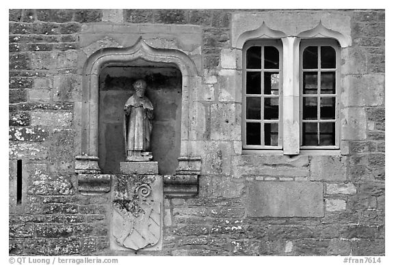 Statue and window, Fontenay Abbey. Burgundy, France (black and white)