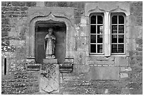 Statue and window, Fontenay Abbey. Burgundy, France ( black and white)