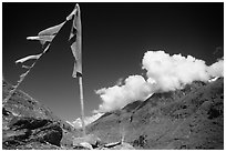 Prayer flag and cloud-capped peak, Himachal Pradesh. India ( black and white)