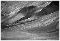 Barren hills with figures walking towards Karsha monastery, Zanskar, Jammu and Kashmir. India (black and white)