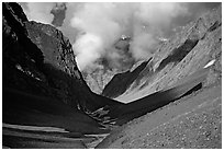 Valley with high cliffs and clouds, Zanskar, Jammu and Kashmir. India (black and white)