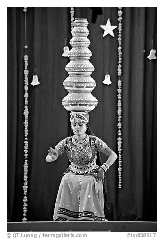 Rajasthani dancer balancing jars on head. New Delhi, India (black and white)