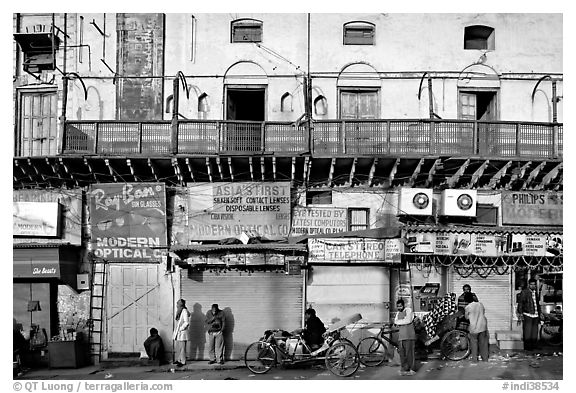 Street with old buildings and storefronts closed, Old Delhi. New Delhi, India (black and white)