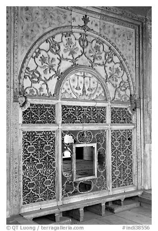 Marble door carved from a single slab with justice symbols, Diwan-i-Khas, Red Fort. New Delhi, India (black and white)