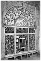 Marble door carved from a single slab with justice symbols, Diwan-i-Khas, Red Fort. New Delhi, India ( black and white)