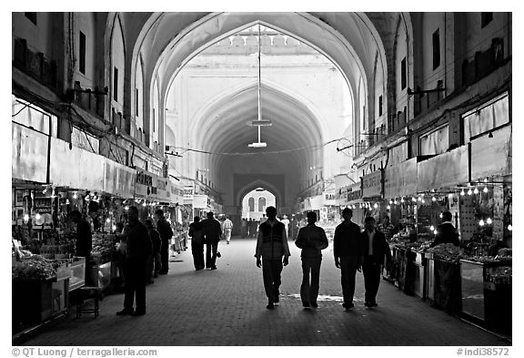 Shops in Chatta Chowk (Covered Bazar), Red Fort. New Delhi, India (black and white)