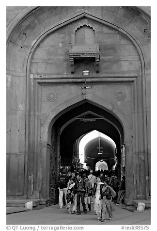 People walking out of the Covered Bazar, Red Fort. New Delhi, India (black and white)