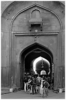 People walking out of the Covered Bazar, Red Fort. New Delhi, India ( black and white)
