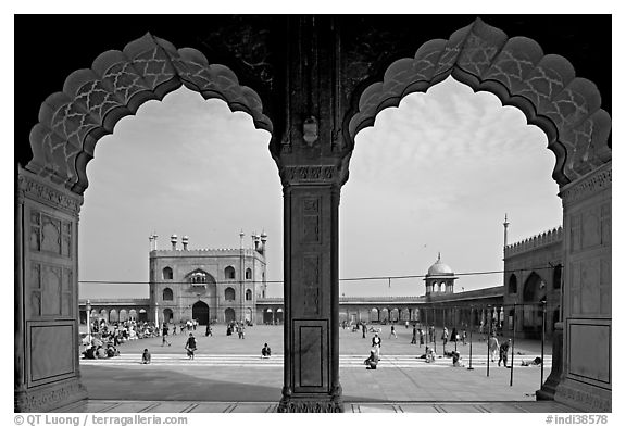 Courtyard of mosque seen through arches of prayer hall, Jama Masjid. New Delhi, India