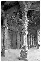 Colums around Quwwat-ul-Islam mosque, Qutb complex. New Delhi, India (black and white)