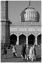 Group of people, courtyard, prayer hall, and dome, Jama Masjid. New Delhi, India ( black and white)