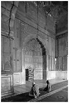 Muslim men praying, prayer hall, Jama Masjid. New Delhi, India (black and white)