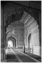Muslim man in prayer, prayer hall, Jama Masjid. New Delhi, India ( black and white)