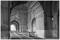 Men in prayer, prayer hall, Jama Masjid. New Delhi, India (black and white)