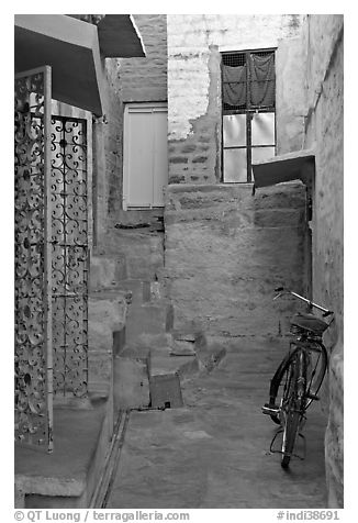 Blue alley with bicycle. Jodhpur, Rajasthan, India (black and white)