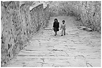 Children walking on the stone ramp leading to the fort. Jodhpur, Rajasthan, India (black and white)