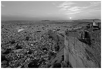 Mehrangarh Fort walls, blue houses, and setting sun. Jodhpur, Rajasthan, India ( black and white)