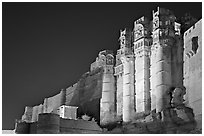 Towers and 36m high walls of Mehrangarh Fort by night. Jodhpur, Rajasthan, India (black and white)