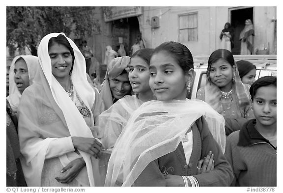 Women standing in the street during a wedding. Jodhpur, Rajasthan, India (black and white)