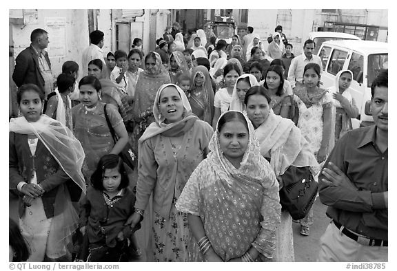 Old town street with wedding procession. Jodhpur, Rajasthan, India (black and white)