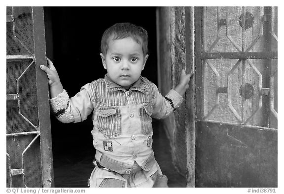 Boy in doorway. Jodhpur, Rajasthan, India