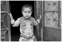 Boy in doorway. Jodhpur, Rajasthan, India (black and white)
