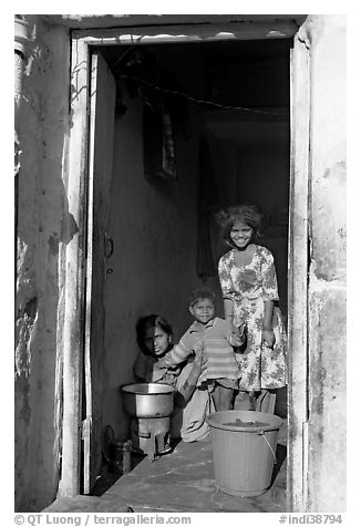 Family inside doorway. Jodhpur, Rajasthan, India (black and white)