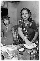 Woman and girl preparing chapati bread. Jodhpur, Rajasthan, India (black and white)