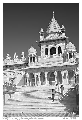 Visitors walking down steps in front of Jaswant Thada. Jodhpur, Rajasthan, India (black and white)