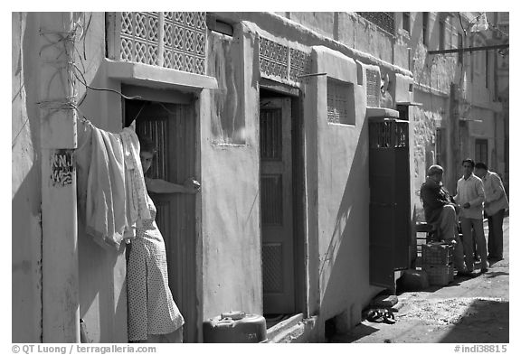 Sunlit street with blue house. Jodhpur, Rajasthan, India (black and white)