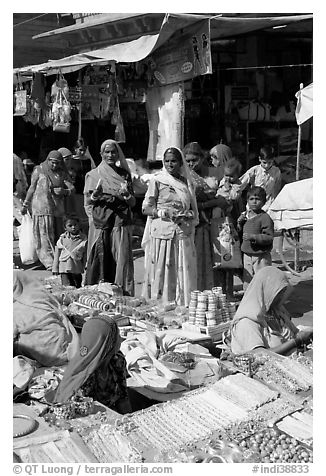Women looking at jewelry stand in Sardar market. Jodhpur, Rajasthan, India (black and white)