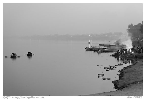 Ganges River at sunset with cremation fire. Varanasi, Uttar Pradesh, India (black and white)