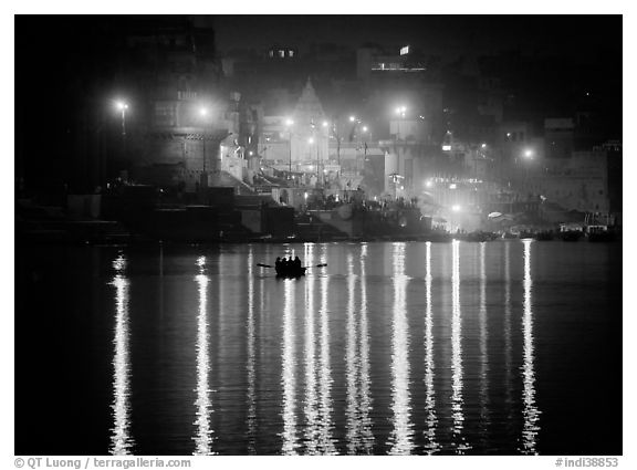 Ganges River at night with Ghat lights  reflected. Varanasi, Uttar Pradesh, India (black and white)